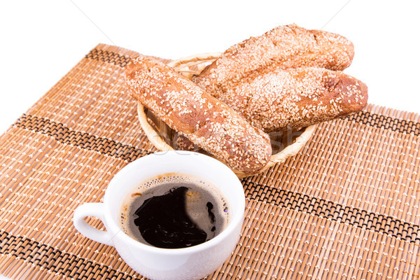 Freshly baked bread rolls with sesame with cup of coffee  Stock photo © Len44ik