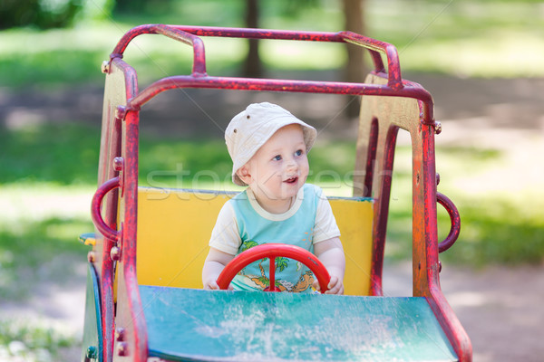 Baby boy driving a toy car at the playground Stock photo © Len44ik