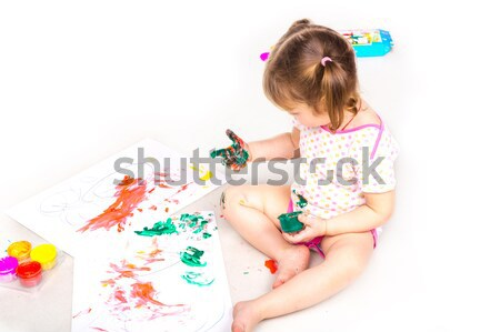Happy baby girl with her hands in paint drawing Stock photo © Len44ik