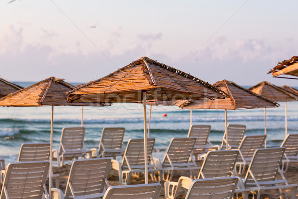 Beautiful view of a resort beach with sunshades Stock photo © Len44ik