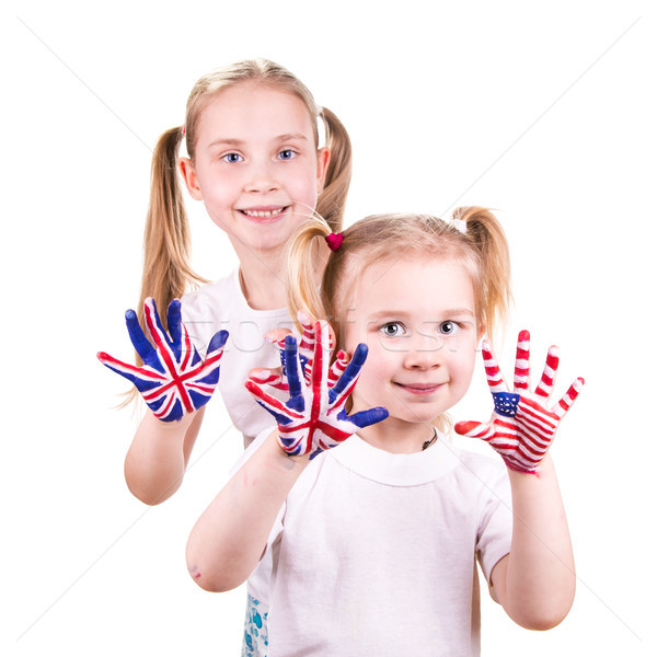 Stock photo: American and English flags on child's hands.