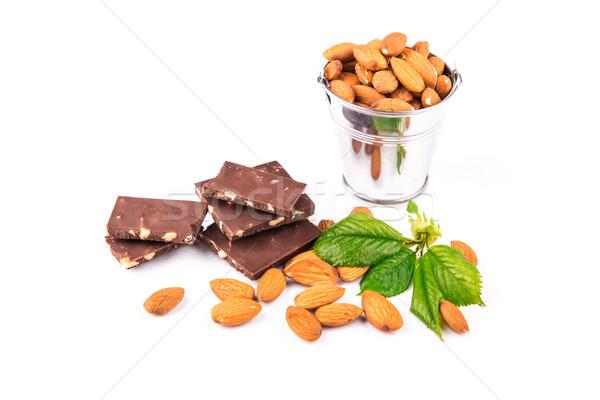 Amandelen stukken chocolade noten geïsoleerd witte Stockfoto © Len44ik