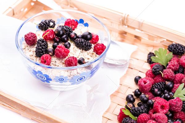 Oat flake porridge with fresh berries Stock photo © Len44ik