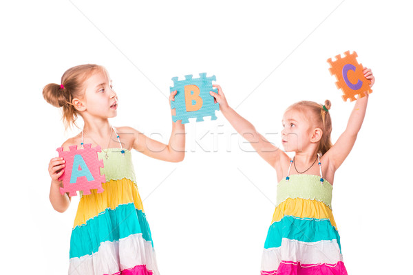 Happy kids holding alphabet letters ABC Stock photo © Len44ik