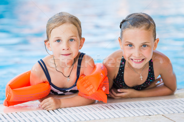 Two cute little girls in swimming pool Stock photo © Len44ik
