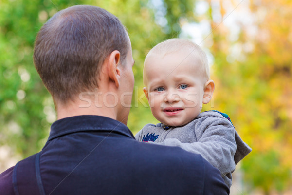 Happy father and his son outdoors. Child hugging daddy. Stock photo © Len44ik