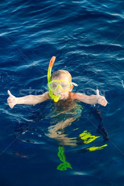 Cute girl snorkeling in water mask Stock photo © Len44ik