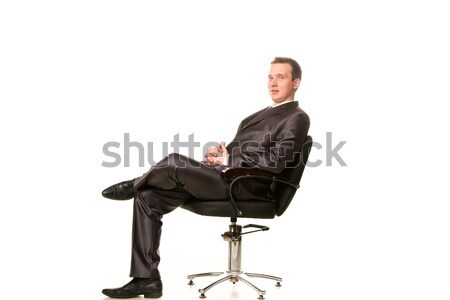 Glimlachend jonge zakenman vergadering stoel geïsoleerd Stockfoto © Len44ik