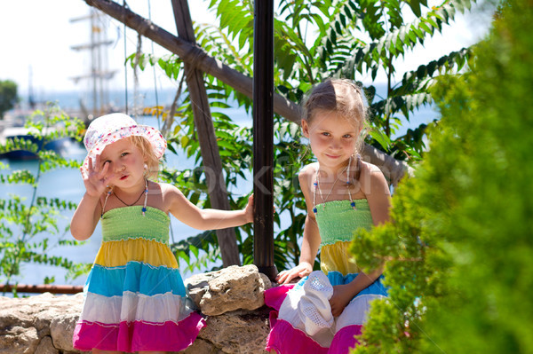 Beautiful little girls at the seaside on holidays  Stock photo © Len44ik
