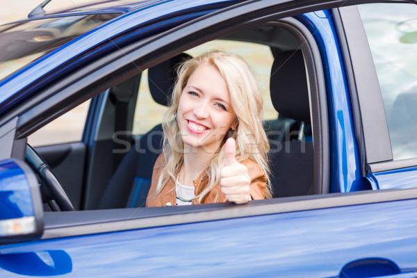Gyönyörű boldog fiatal lány ül autó üzlet Stock fotó © Len44ik