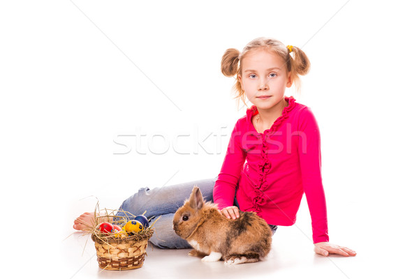 Stock photo: Happy little girl with easter bunny and eggs. Happy Easter