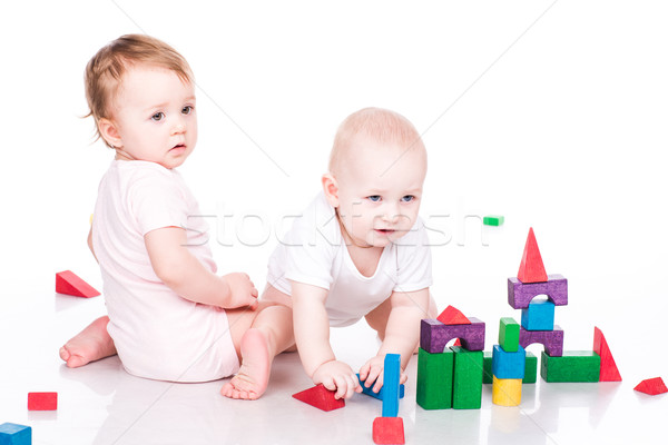 Beautiful babies building with cubes Stock photo © Len44ik