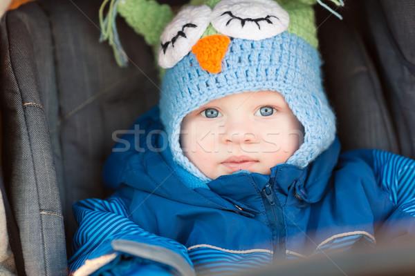 Stock photo: Cute little baby in a stroller