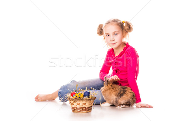 Happy little girl with easter bunny and eggs. Happy Easter Stock photo © Len44ik
