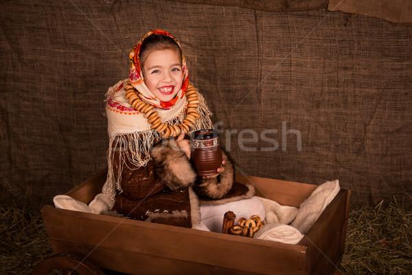 Gyönyörű orosz lány ül kosár iszik Stock fotó © Len44ik