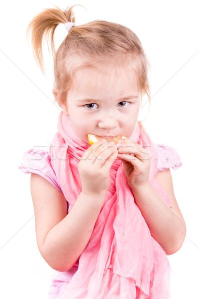 Doente little girl alimentação limão isolado branco Foto stock © Len44ik