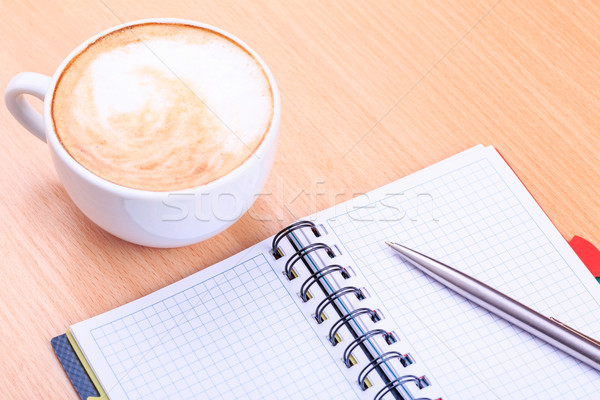 Stock photo: Open blank note book with coffee cup on table