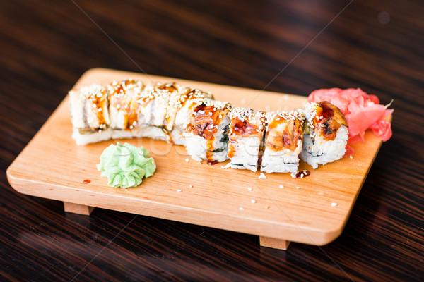 Szusi tekercsek felszolgált fából készült tányér étterem Stock fotó © Len44ik