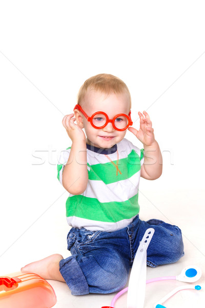 Cute baby boy trying on glasses playing doctor Stock photo © Len44ik