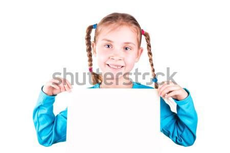 Smiling little girl holding white card for you sample text Stock photo © Len44ik