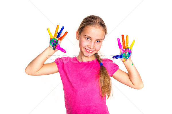 Stock photo: Happy little girl with her hands in paint