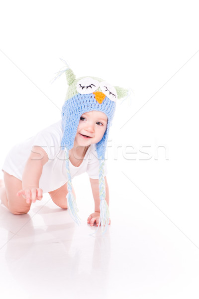 Cute little baby crawling in a owl hat Stock photo © Len44ik