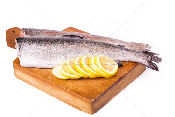 Two split trouts with a lemon ready to be cooked Stock photo © Len44ik