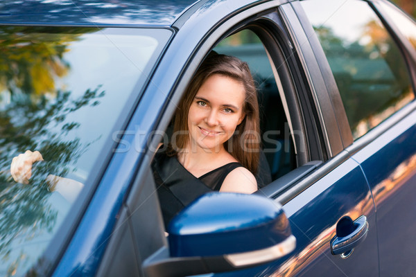 Beautiful businesswoman sitting in the car Stock photo © Len44ik