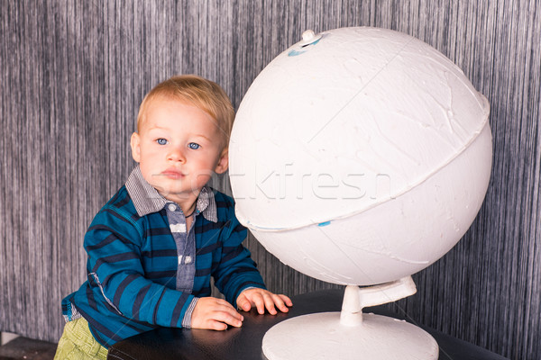 Adorable curious baby boy with a globe Stock photo © Len44ik