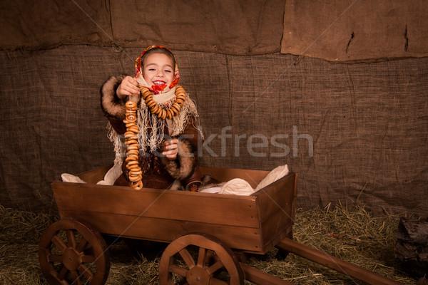 Beautiful russian girl in a shawl  sitting in a cart  Stock photo © Len44ik