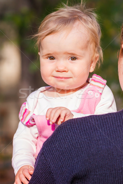 Cute baby girl looking out from mother's back Stock photo © Len44ik