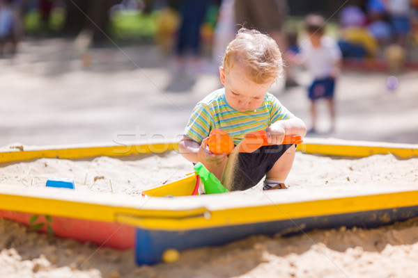 Cute baby boy playing with sand Stock photo © Len44ik