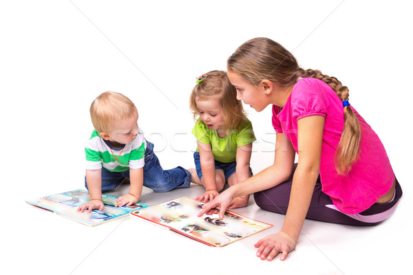 Happy kids reading a book isolated on white Stock photo © Len44ik