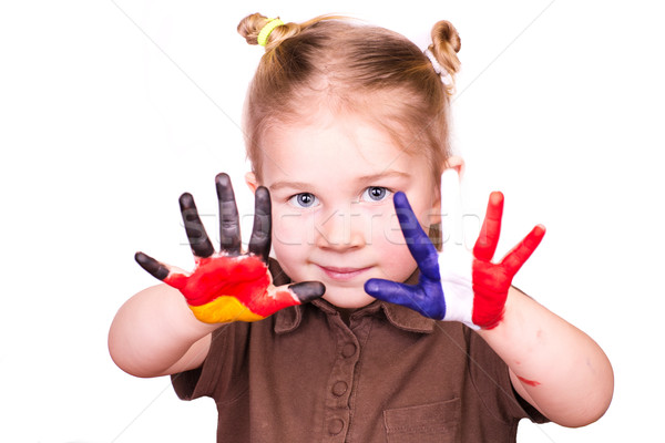Beautiful girl with hands painted as German and French flags Stock photo © Len44ik
