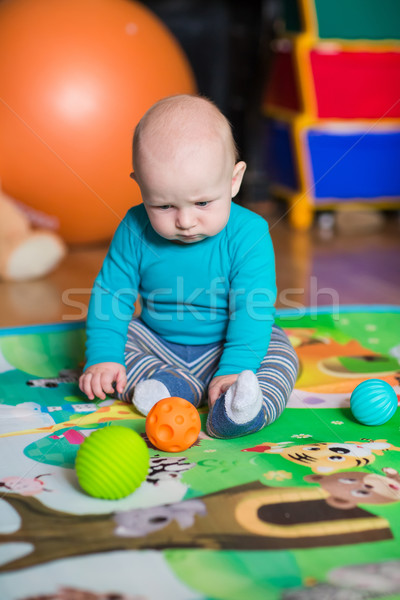 Cute little baby playing with colorful toys Stock photo © Len44ik