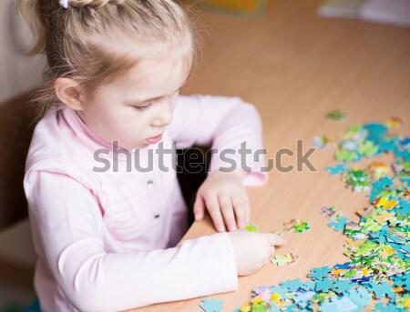 Sevimli küçük kız oynama bebek mutlu saç Stok fotoğraf © Len44ik