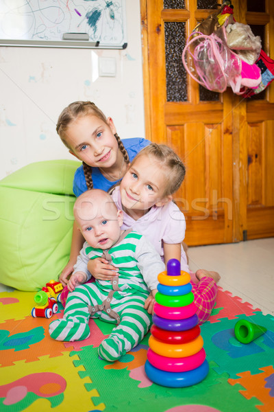 Happy kids playing with little brother Stock photo © Len44ik