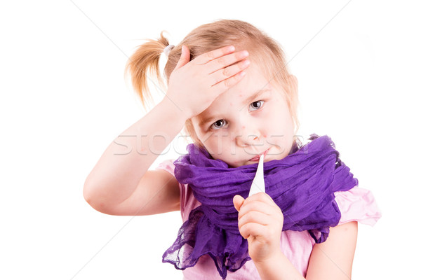 Sick little girl with chickenpox measuring temperature and checking her forhead Stock photo © Len44ik