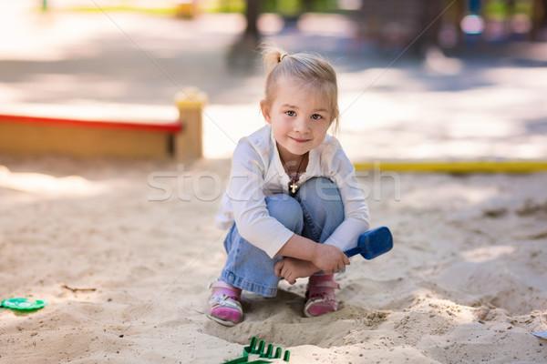 Happy little girl playing in a sendbox Stock photo © Len44ik