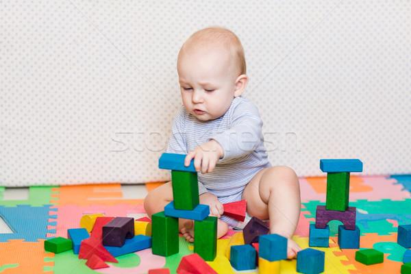 Cute wenig Baby spielen farbenreich Spielzeug Stock foto © Len44ik