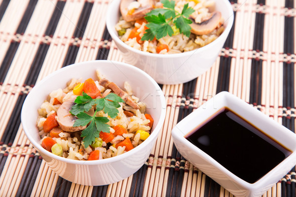 Rice with vegetables and mushrooms with soy sauce Stock photo © Len44ik