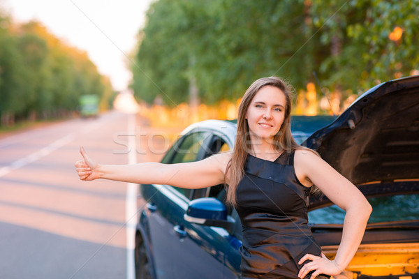 Beautiful business woman near the broken car, hitch-hiking Stock photo © Len44ik