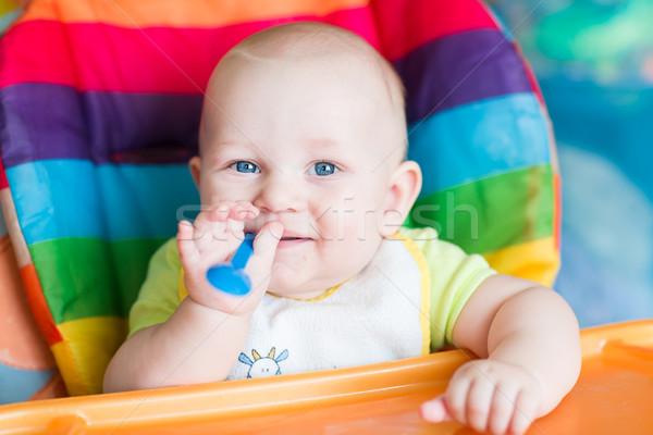 çok güzel bebek yeme yüksek sandalye ilk Stok fotoğraf © Len44ik