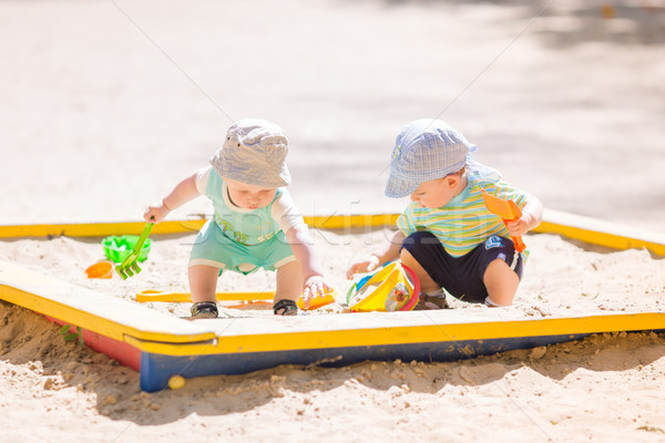 Two baby boys playing with sand Stock photo © Len44ik