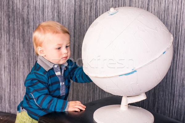 Adorable curious baby boy with a globe Stock photo © Len44ik