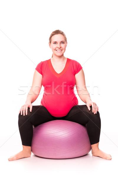Femme enceinte isolé blanche gymnastique actif Photo stock © Len44ik