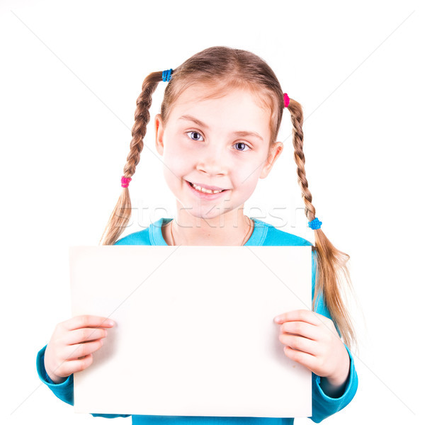 Stock photo: Smiling little girl holding white card for you sample text