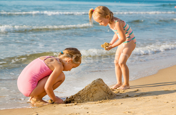 Adorable little girls playing at the seashore Stock photo © Len44ik