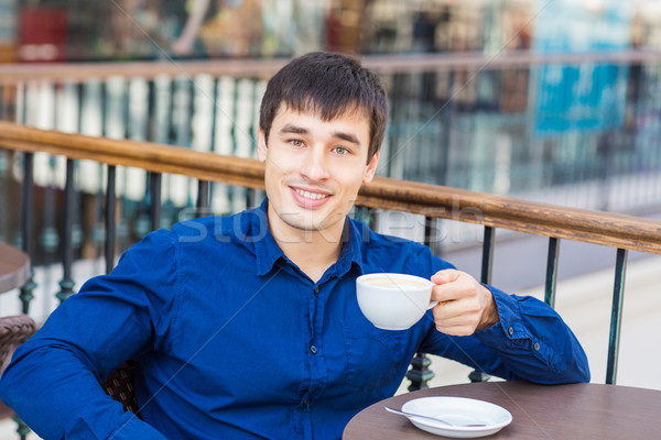 Handsome young man drinking coffe  Stock photo © Len44ik
