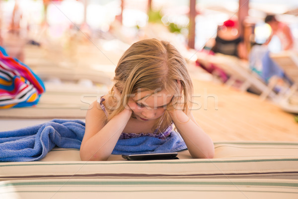 Cute little girl learning with tablet pc Stock photo © Len44ik